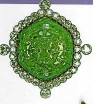 durbar delhi brooch, a carved emerald surrounded by diamond
