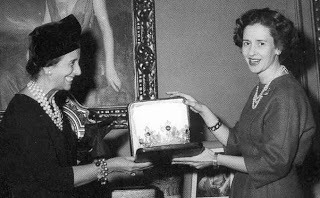 madame franco gives the Spanish Wedding Gift Tiara to Queen Fabiola of Belgium