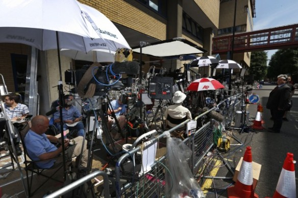 the press fills the sidewalk outside St, Mary's Hospital, waiting for the legendary labor to begin